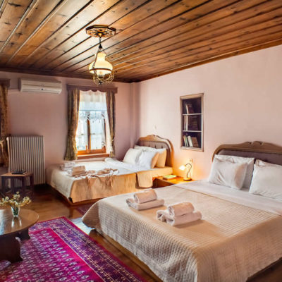 """The hotel """"En Chora Vezitsa"""" in Vitsa village, Zagorochoria, allocates 10 big rooms for 2, 3, and 4 individuals and a luxurious loft, with baths, fireplace and free internet"""